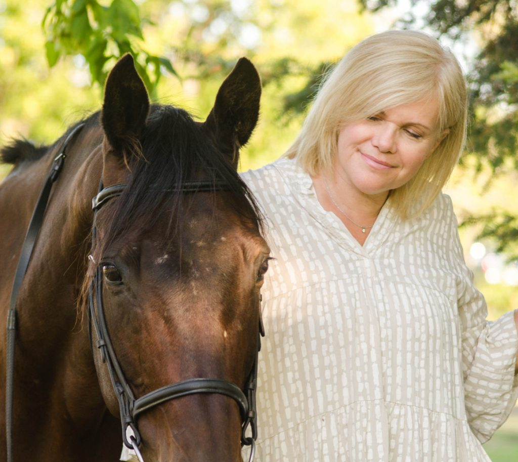 Denise smiling with her horse